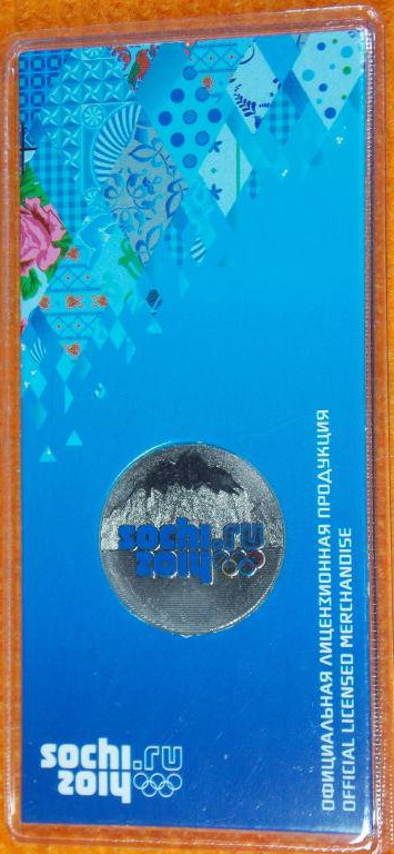 Фото олимпийской монеты Горы
